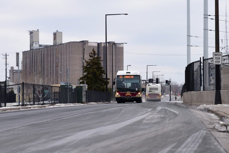 Campus connectors travel between Minneapolis and St. Paul campuses via the University's Transitway on Sunday, Dec. 10. The University is in talks with the Prospect Park Association to potentially relocate the Transitway to allow for further development of the neighborhood.