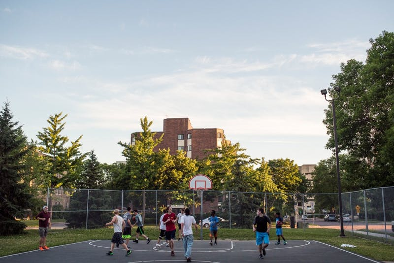 A group plays a game of pick-up basketball at Holmes Park located in the Marcy-Holmes neighborhood of Minneapolis on June 22, 2016.