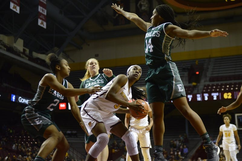 Sophomore forward Taiye Bello avoids a block during a game against East Michigan on Sunday Dec. 3 at Williams Arena.