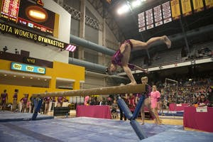 Freshman Lexy Ramler performs her beam routine at the Maturi Pavilion on Saturday, Jan. 20.