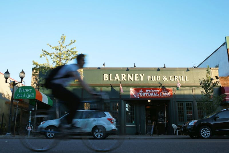 A biker passes by Blarney Pub & Grill on Sept. 30, 2015.