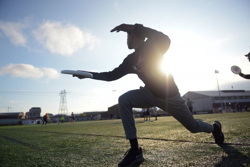 Captain Saurav Dubey throws a frisbee at teammates during practice on Wednesday, Oct, 11.
