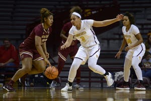 Freshman Destiny Pitts attempts to steal the ball from a Boston College player on Sunday, Nov. 19 at Williams Arena.
