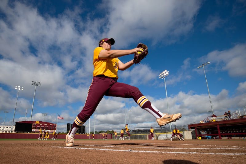 Pitcher Sydney Smith warms up before a game on October 7, 2017.