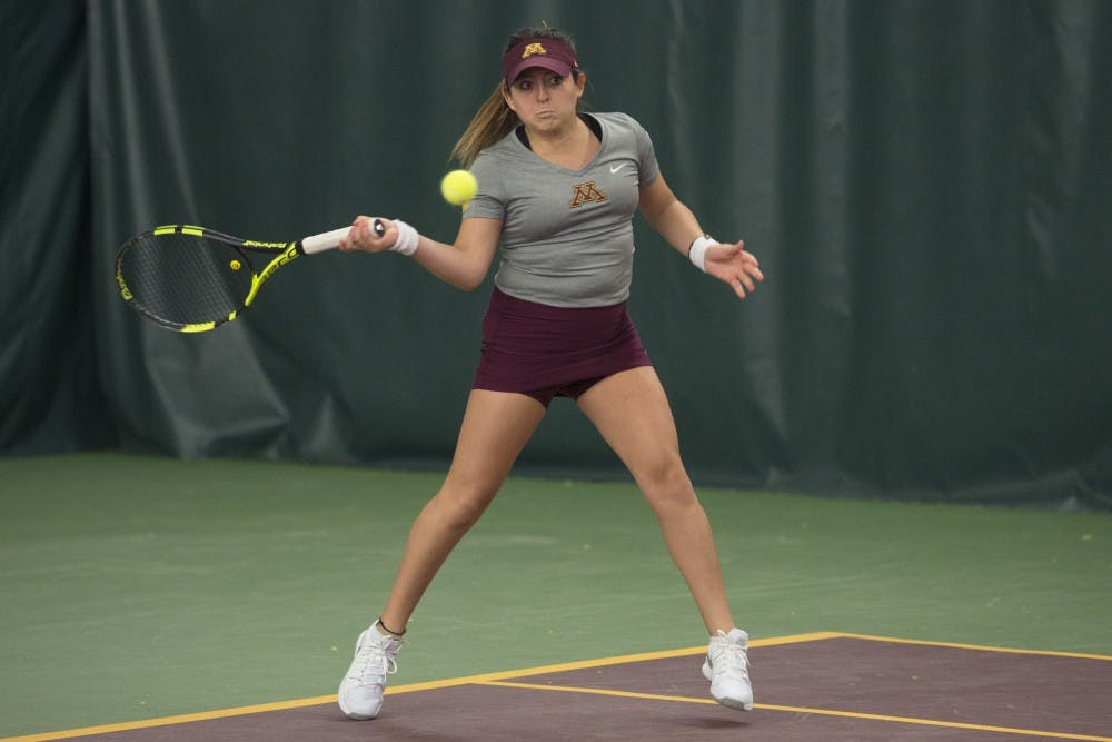 Women's tennis coach gets her first career victory; Men's team can't advance to ITA Indoor Finals