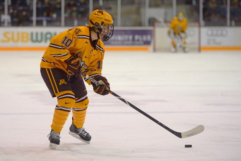 Forward Cara Piazza looks to pass the puck at the Ridder Arena on Saturday, Nov. 18.