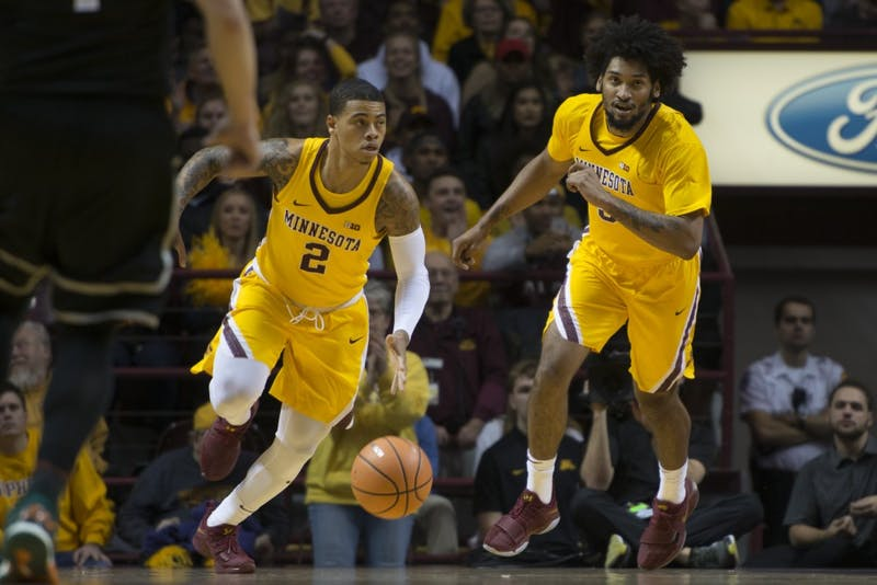 Guard Nate Mason is followed by forward Jordan Murphy as the Gophers bring the ball up the court at the Williams Arena on Wednesday, Nov. 29.