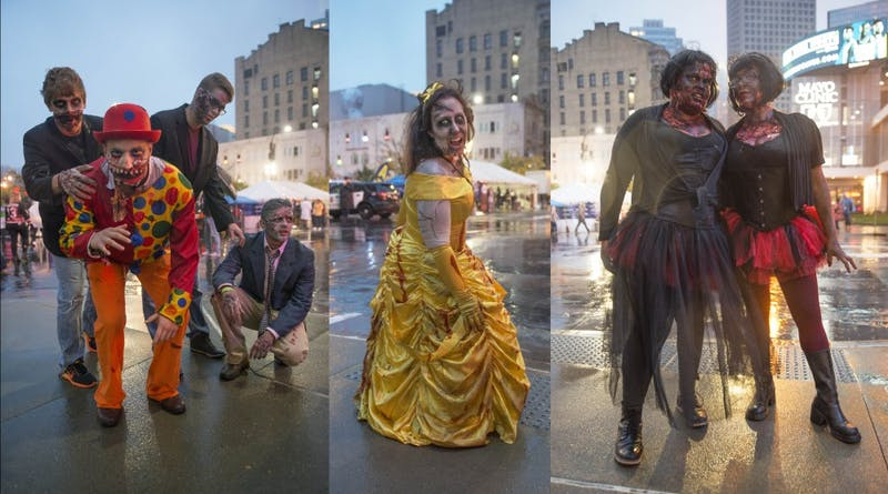 Left: Roman Chrischilles, center, poses with his friends to show off their zombie costumes during the Zombie Pub Crawl on Saturday in downtown Minneapolis. 