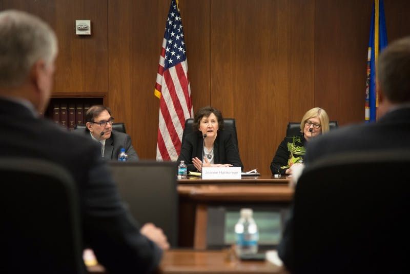 Jeanne Hankerson, center, answers an audience question about tuition during the 2018 Regent Candidate Forum at the State Office Building on Wednesday, April 25.