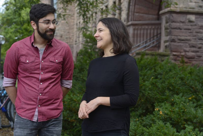 Arab Film Festival Director and UMN PhD Student Michelle Baroody poses for portraits with Program Coordinator Jordan Lee Thompson outside of Pillsbury Hall on Tuesday.