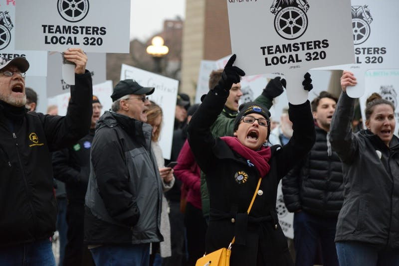Hannah Bernardson, a business agent for the union group Teamsters Local 320, protests on Friday, Nov. 17, outside Morrill Hall in Minneapolis. The group is fighting for fair wages at the University of Minnesota.