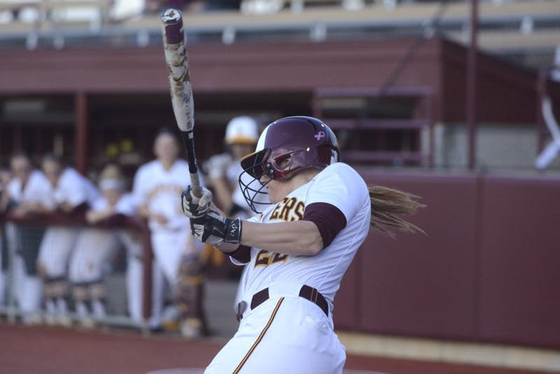 Junior Taylor Chell swings during a game against South Dakota on Tuesday, Apr. 4, 2017.