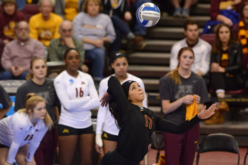 Senior libero Dalianliz Rosado readies to hit the ball during a match against the Bruins at Maturi Pavilion on Dec. 10, 2016.