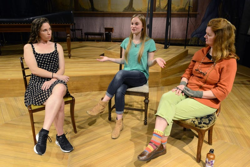 "Isabel Enns, left, Tessa Dahlgren, middle, and Kate Powers, right, discuss their work in the play ""In the Next Room"" on Friday, Oct. 20 in the Rarig Center on West Bank. The play debuts at the Rarig Center on Nov. 2."