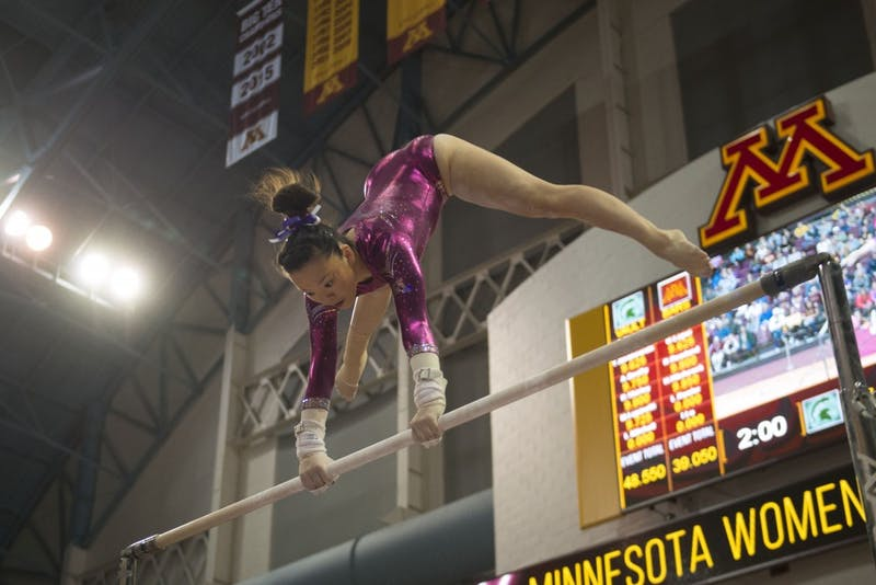 Sophomore Ivy Lu performs her bars routine at the Maturi Pavilion on Saturday, Jan. 20. The Gophers defeated the Michigan State Spartans 196.075 to 194.925.