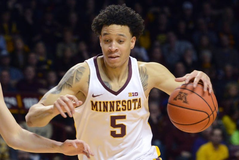 Freshman guard Amir Coffey drives the ball up the court on Saturday, Jan. 28, 2017 at the Sports Pavilion.