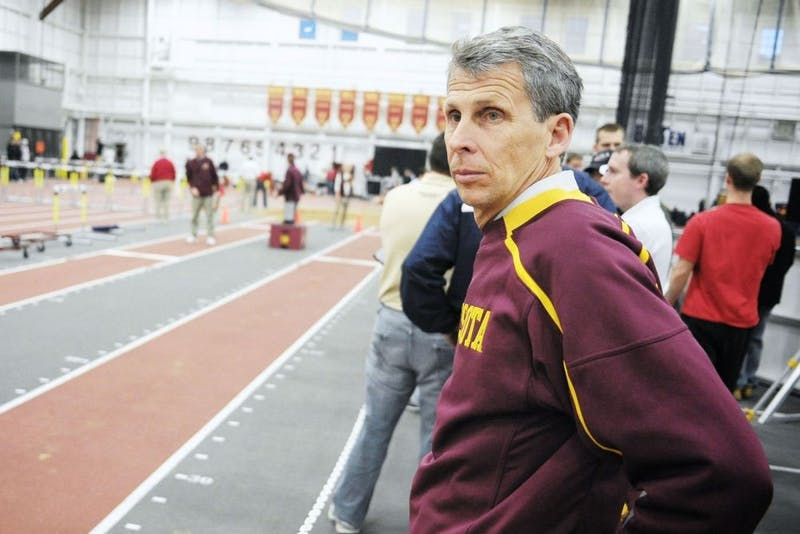Head men's track and field coach Steve Plasencia watches his team compete last February. Plasencia won his first five Big Ten championships with Minnesota from 2009-11 but finished second indoors and seventh outdoors this season.