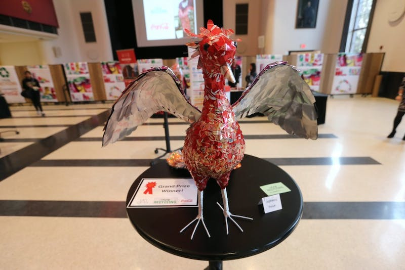 Stephanie Finch's phoenix made of all recycled materials, which won the grand prize, is displayed at the Art of Recycling Exhibition on Wednesday, April 11 at Coffman Union. The grand prize winner received a Tablet Pro.