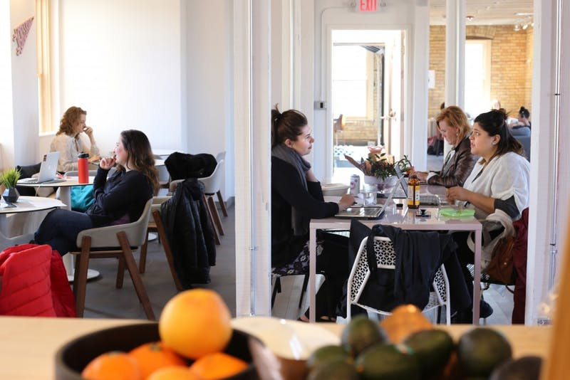 The Coven is filled with working women on Tuesday, March 27 in the North Loop. The space encourages women and non-binary individuals to find community while accomplishing personal and professional work in the space.