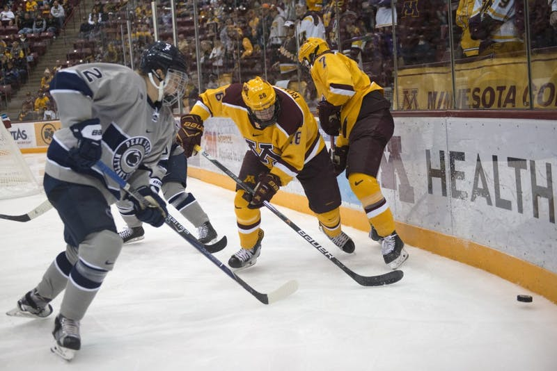 Forward Darian Romanko fights for the puck at 3M Arena at Mariucci on Saturday, Oct. 15.