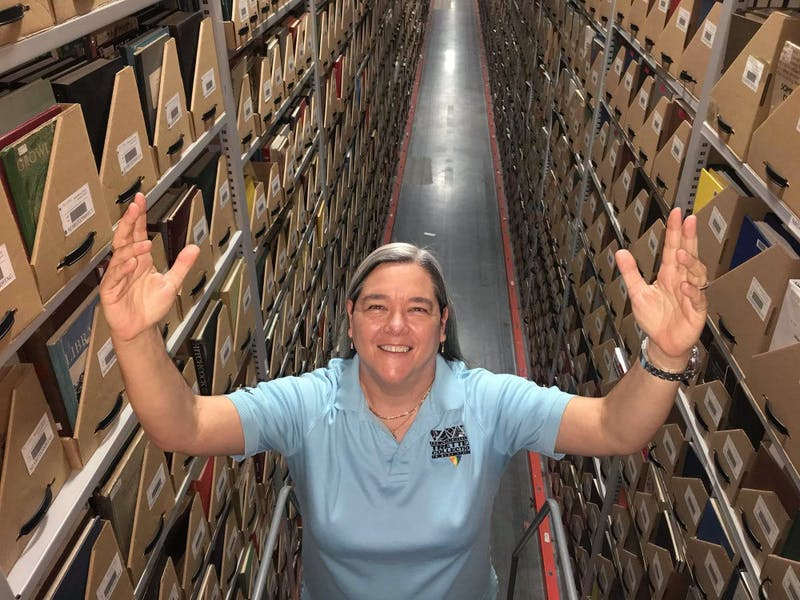 Curator of the Tretter Collection Lisa Vecoli poses for a portrait in the University archives.