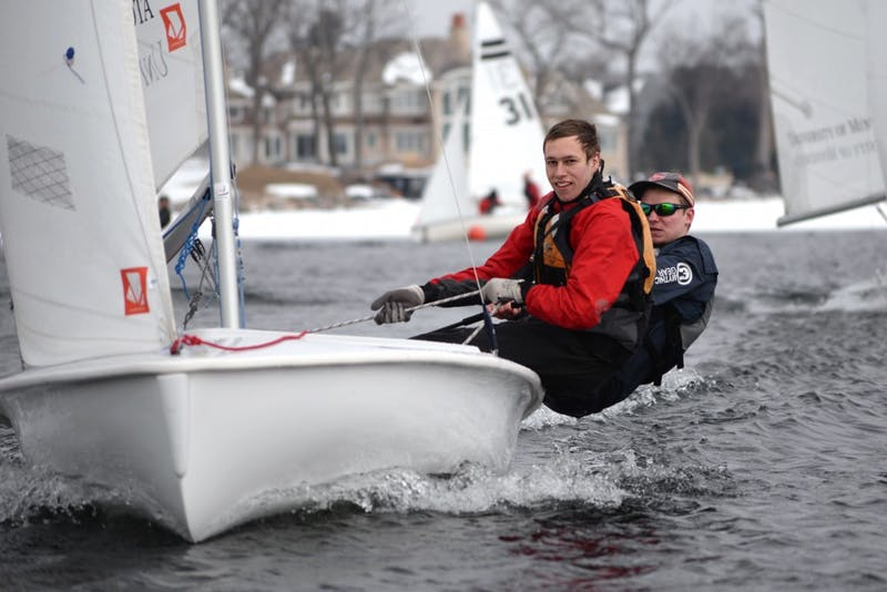 Matt Granstrom left, and Ryan Sigurdson practice starting drills with three other sail boats during practice on Wayzata Bay on Tuesday, April 10.