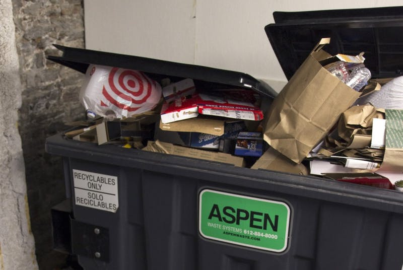 A recycling bin begins to overflow at Northstar Apartments on Sunday, Oct. 15