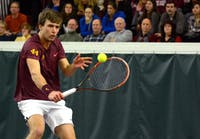 Gophers senior Matic Spec returns the ball to South Florida in the Baseline Tennis Center on Friday, Feb. 5, 2016.