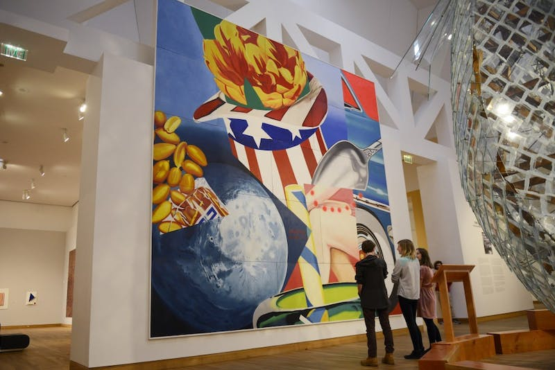 "People view James Rosenquist's mural ""World's Fair Mural"" at Weisman Art Museum on April 12, 2017."