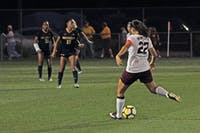 Tori Burnett passes the ball to a teammate in the game against the University of Michigan on Sept. 21.