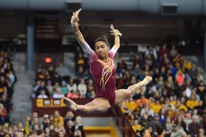 Senior Ciara Gardner leaps during her floor routine. Gardner scored a 9.725 and placed fourth overall on her floor exercise during a home meet on Saturday, Jan. 13.