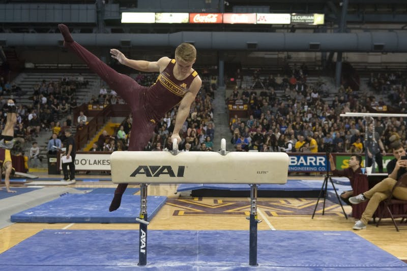 Freshman gymnast Shane Wiskus preforms on the pommel horse during a meet on Jan. 27, 2018 at Maturi Pavillon.