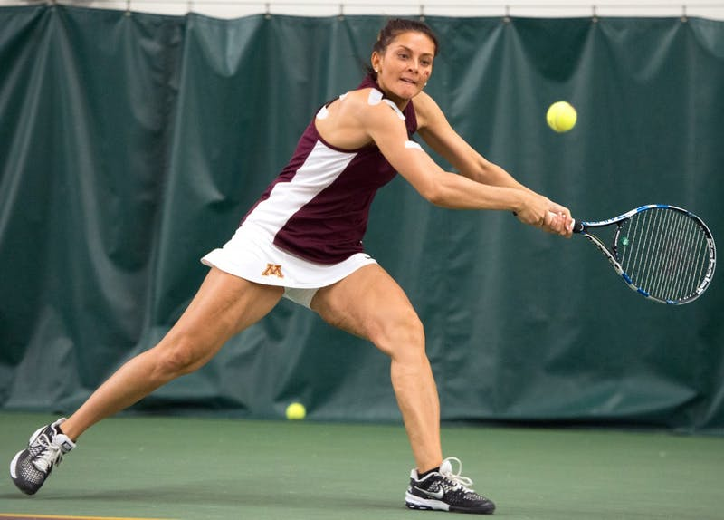 Julia Courter plays for the Gophers during a game in 2016. Courter now coaches tennis at Hamline University.