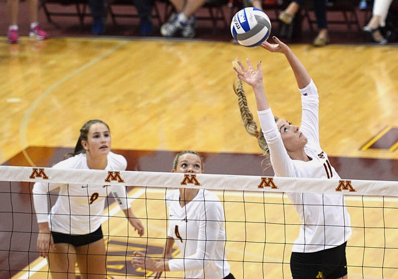 Gophers junior Samantha Seliger-Swenson sets the ball on Friday, Sept. 23, 2016 in a match against Maryland in the Sports Pavillon.