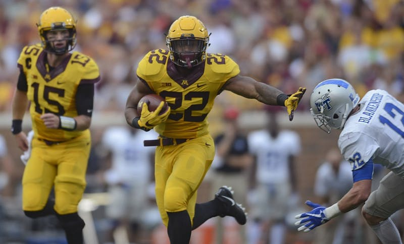 Running back Kobe McCrary runs with the ball on Saturday, Sept. 16 at TCF Bank Stadium in Minneapolis.