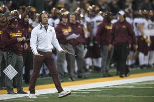 Head coach P.J. Fleck offers words of advice to his players in between plays at Kinnick Stadium on Saturday, Oct. 28.