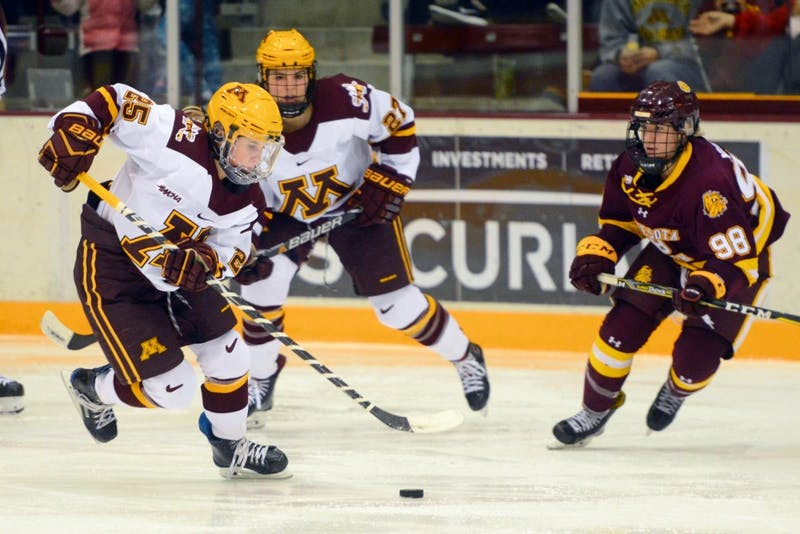 Redshirt junior forward Nicole Schammel skates with the puck on Friday, Dec. 8 at Ridder Arena.