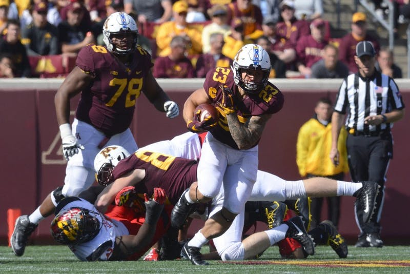 Running Back Shannon Brooks runs the ball on Sept. 30, 2017 at TCF Bank Stadium.