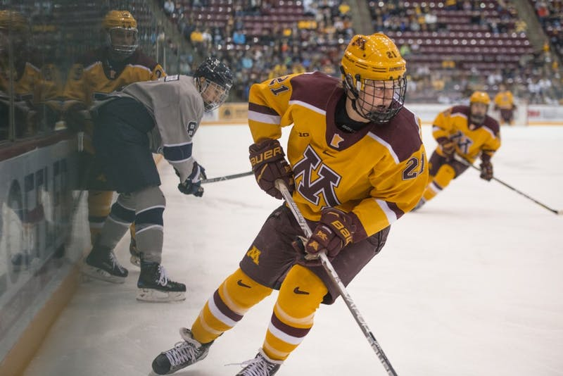 Forward Casey Mittelstadt follows the puck during the Gophers' game against Penn State on Sunday at 3M Arena at Mariucci. The Gophers won 6-3.
