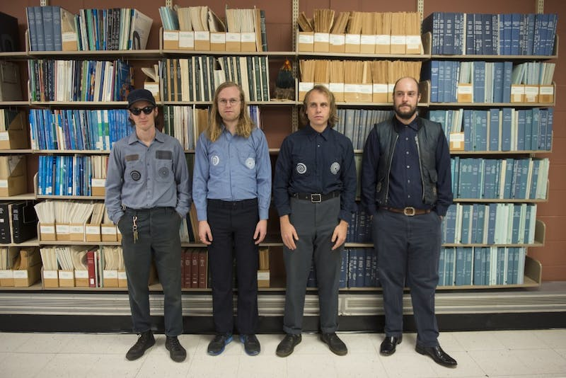 Local punk band Uranium Club pose for portraits in Wilson Library on West Bank on Sunday, Dec. 3.