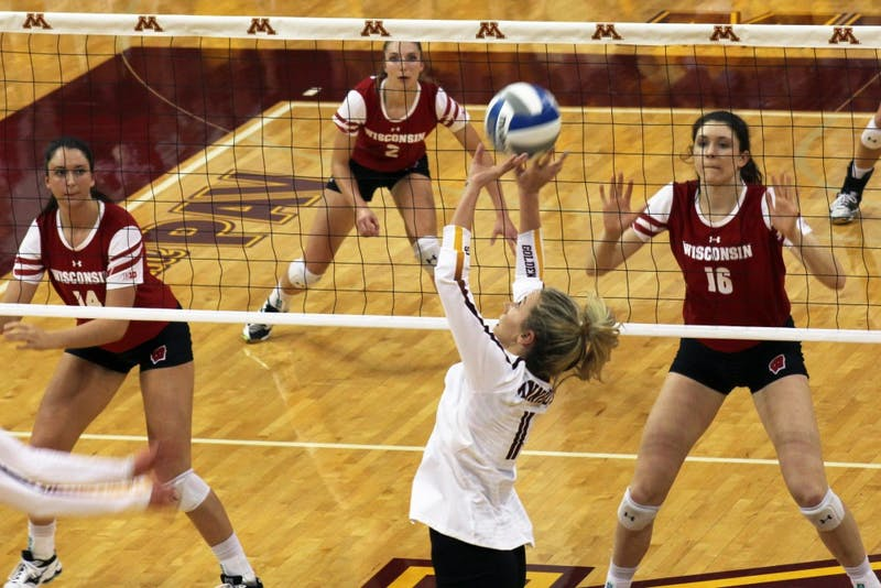 Setter Samantha Seliger-Swenson sets the ball at the Gophers game against the Badgers at the Maturi Pavilion on Saturday, Oct. 21.