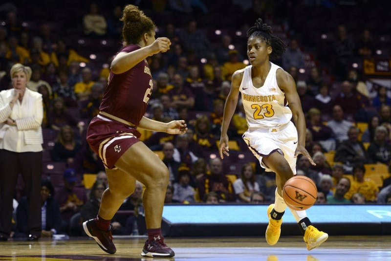Kenisha Bell dribbles the ball on Sunday, Nov. 19 at Williams Arena.