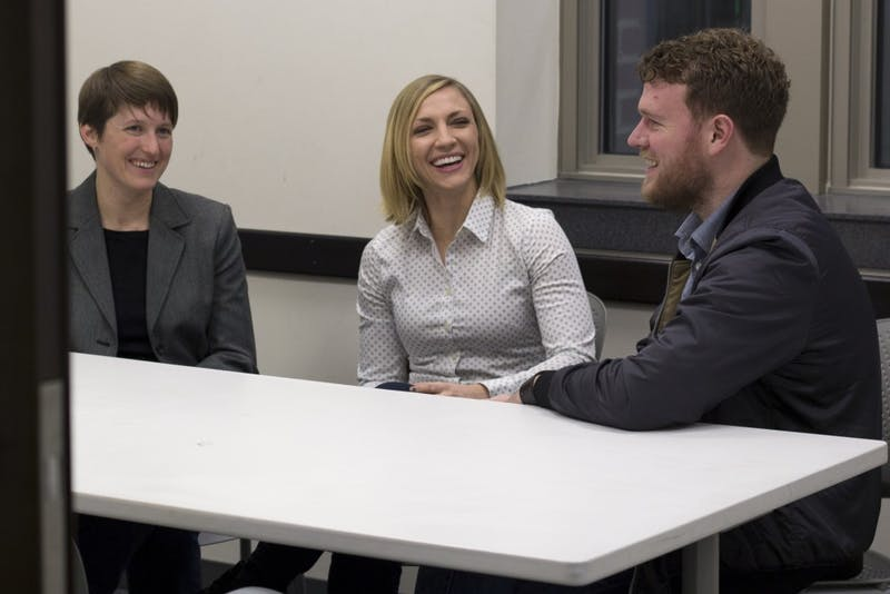 Candidates for Professional Student Government President Sonya Ewert, left, Alanna Pawlowski, and Michael Sund chat while posing for portraits in Coffman Memorial Union on Monday.