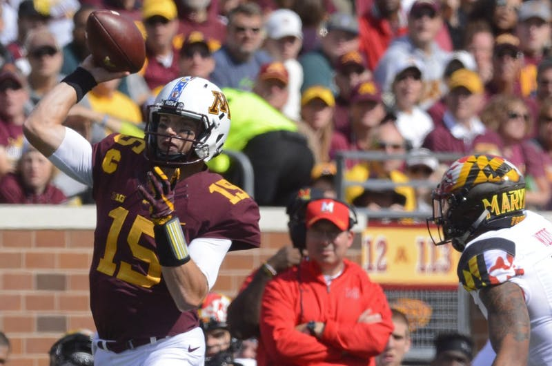 Quarterback Conor Rhoda throws the ball on Saturday at TCF Bank Stadium in Minneapolis.