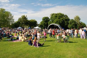 """""""Tenterden, England - June 13, 2009: The audience watching the free local music festival at Tenterden in Kent. The annual event held in the local public park showcases local talent."""""""