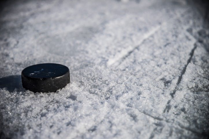 Hockey Puck on Chewed Ice with Skate Marks