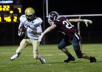 Athens' Treyce Albin dodges a Vinton County defender during Friday's game.