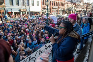 A speaker preaches to the crowd gathered outside the Athens courthouse during a rally following the Womens March in Athens, Ohio, on Jan. 20, 2018.