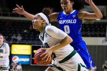 Ohio's Amani Burke (#3) attempts to escape the Buffalo defense in The Convo on Wednesday. (FILE)