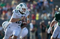 Quarterback Nathan Rourke carries the ball up the field during Ohio's win against Eastern Michigan on Saturday.